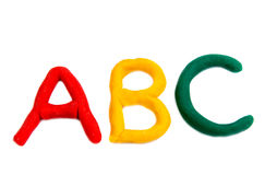 Farbige Buchstaben vom Plasticine lokalisiert Lizenzfreie Stockfotografie