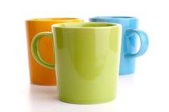 Farbige Cup. Getrennt auf weißem Hintergrund. Lizenzfreie Stockbilder