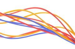 Farbige Drähte benutzt in elektrischem und in den Computernetzwerken lizenzfreie stockfotografie