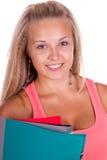Farbige Faltblätter der jungen Frau Holding Stockfotos