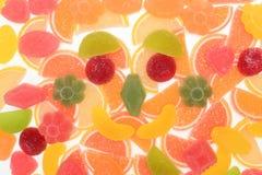 Farbige Fruchtmarmelade Zitrone, Apfel, Orange, Pampelmuse Geleefarbhintergrund stockfoto