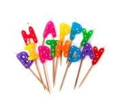 Farbige Geburtstagskerzen lokalisiert auf Weiß lizenzfreie stockfotos