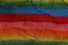 Farbige gestreifte Beschaffenheit eines Stückes des zerknitterten Stoffes Stockbilder