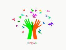 Farbige Hände, bunte Vögel produzierend Stockbilder