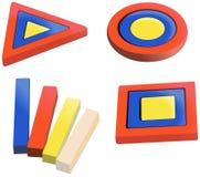 Farbige hölzerne Puzzlespiele für kleine Kinder Lizenzfreie Stockfotos