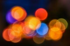 Farbige Kreise auf einem schwarzen Hintergrund Stockfotos