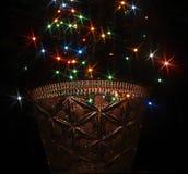 Farbige Lichter in Form von sechs-ausgestrahltem Stern im Glas Stockbild