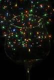 Farbige Lichter in Form von sechs-ausgestrahltem Stern im Glas Lizenzfreies Stockbild