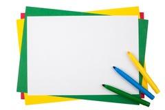 Farbige Markierungen auf einem Rahmen vom mehrfarbigen Papier Stockfotografie