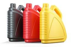 Farbige Plastikdosen Motorenöl Stockbilder