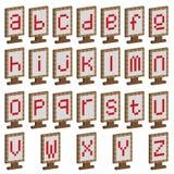 Farbige Platten mit Alphabet Stockfotografie