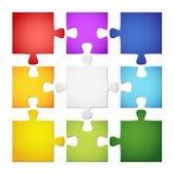 9 farbige Puzzlespielstücke Stockbild