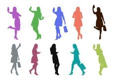 Farbige Schattenbilder von womanwith Telefon im Satz Lizenzfreie Stockfotografie