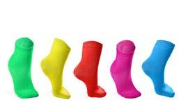 Farbige Socken, die Schritte nachahmen Stockfotos