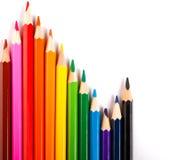 Farbiger Bleistiftentzerrer auf weißem Hintergrund Stockfotografie