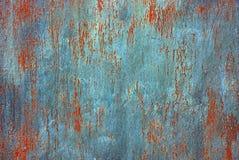 Farbiger Hintergrund von einem Stück einer rostigen Platte des alten Eisens Stockbilder