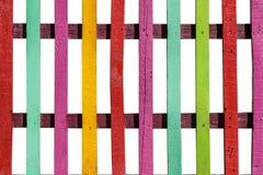 Farbiger und heller Kind-` s Zaun auf Weiß Stockfotos