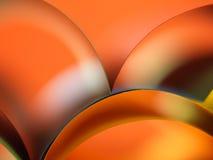 Farbiges Papier des Auszuges auf orange Hintergrund Lizenzfreie Stockbilder