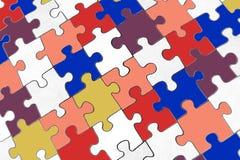 Farbiges Puzzlespiel mit Weiß Lizenzfreies Stockfoto
