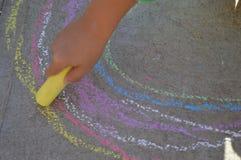 Farbkreide rainwob Zeichnung auf der Straße Lizenzfreies Stockfoto