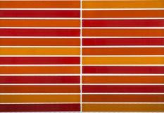 Farborange Mosaikfliesenhintergrund Stockbild