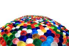Farbplastik bedeckt Hintergrund mit einer Kappe Stockfotografie