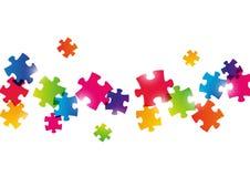Farbpuzzlespielhintergrund Stockfotos