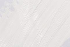 Farby muśnięcia uderzenie nad białym papierem Obrazy Royalty Free