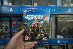 Farcry 4. Bratislava, Slovakia, circa april 2017: Man holding Farcry 4 videogame on Sony Playstation 4 console in store Stock Photo