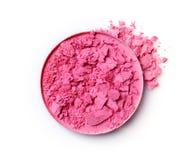 Fard à joues brisé rose rond pour le maquillage comme échantillon de produit cosmétique Photographie stock