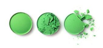 Fard à paupières brisé vert rond pour le maquillage comme échantillon de produit cosmétique photos stock