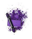 Fard à paupières et applicateur violets écrasés photos stock