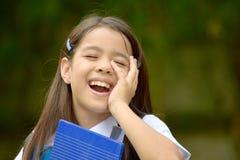 Farda da escola de And Laughter Wearing da estudante imagem de stock royalty free