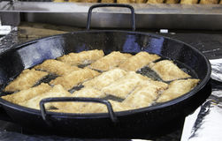 Fardelejos in frying pan Stock Photography