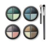 Fards à paupières multicolores avec des applicateurs de maquillage Photographie stock libre de droits