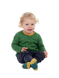 Fare da baby-sitter biondo adorabile sul pavimento Fotografie Stock Libere da Diritti