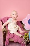Fare da baby-sitter sullo strato Fotografia Stock
