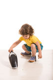 Fare piazza pulita del ragazzo del bambino Fotografie Stock