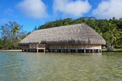 Fare potee shore Maeva Huahine French Polynesia. The Fare Potee built on stilts over the water on the shore of the lake Fauna Nui, Maeva, Huahine island, French Stock Photo