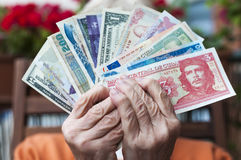 Fare. Senior holding several bills in his hands Stock Photo