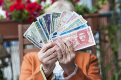 Fare. Senior holding several bills in his hands Royalty Free Stock Photos