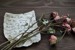Farewell letter with withered roses royalty free stock photography