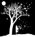 Farewell to dreams. Black and white fantasy: a tree, the moon and the girl, letting butterflies out of the cage Stock Image