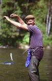 Farfadern fångade en fisk Arkivfoto