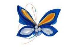Farfalla del giocattolo fatta dei nastri Fotografie Stock