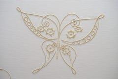 Farfalla del ricamo su cotone Immagini Stock