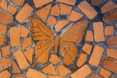 Farfalla sulla sedia di giardino Fotografia Stock Libera da Diritti