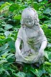Farfalla sulla statua Immagine Stock