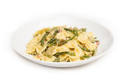 Farfalle with asparagus and bacon Royalty Free Stock Photography