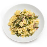 Farfalle with asparagus and bacon Stock Photography